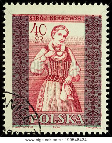 Moscow Russia - August 12 2017: A stamp printed in Poland shows woman in Polish traditional costume Cracow region series
