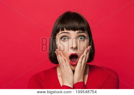 Astonished young female. Surprise emotion. Shocking news for beautiful girl, pretty woman portrait, facial expression concept