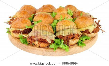 Group of small shredded beef sandwich sliders with melted cheese isolated on a white background