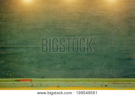 Vintage Green Chalkboard With Eraser And Chalk Rubbed Out On Blackboard. Horizontal Composition With