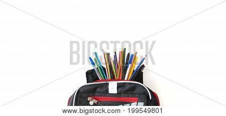 Closeup of colored pencils in a backpack, back to school