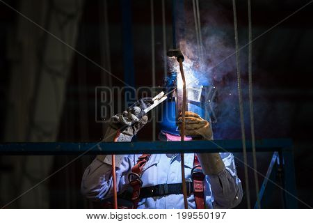 Steel welding or welder industrial in the factory with smoke from welding job. Harm will happen to health of welder smoke inhalation from steel welding.