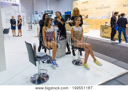 BERLIN - SEPTEMBER 04 2015: Stand of company BaByliss. Demonstration of stylists and makeup artists. International radio exhibition Berlin (IFA2015).