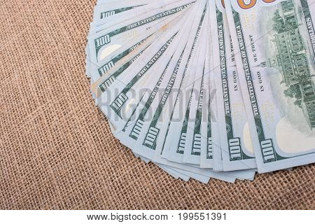 Banknotes of US dollars on canvas on a linen canvas