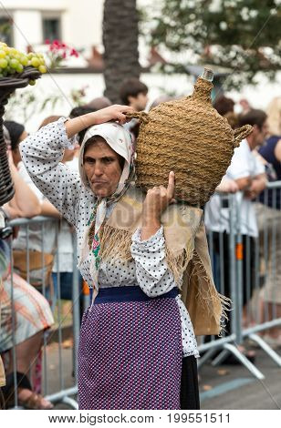 FUNCHAL PORTUGAL - SEPTEMBER 4 2016: Woman in traditional costume durnig historical and ethnographic parade of Madeira Wine Festival in Funchal. Madeira Portugall