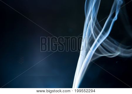 Blue Smoke Isolated On Dark Background