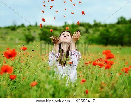 happy young ukrainian woman in poppy field