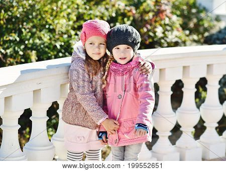 Two Girls Hugging Outdoors