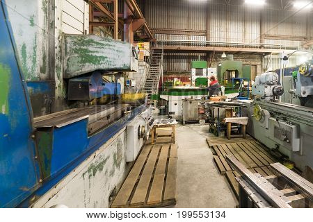 Metalworking shop. Guillotine shears, grinding and lathes