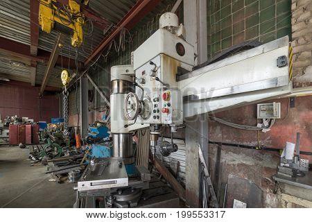 Modern radial drilling machine. Shop processing metal cutting.