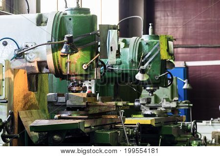 Mechanical vertical milling machine. Shop metal processing plant.