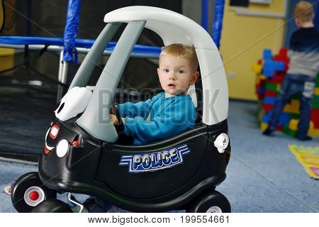 boy in car in the theme park