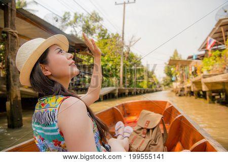 Woman Waving Goodbye At Canal Boat