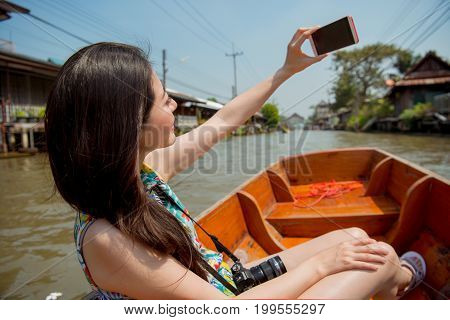 Asian Tourist Taking Self-portrait Photo