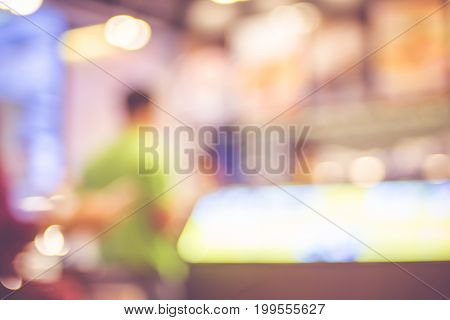 Blurred Background ,customer At Counter Bar In Coffee Shop With Bokeh Light,vintage Filter