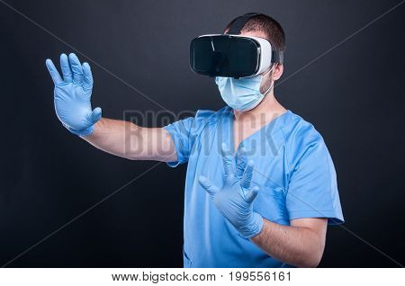 Surgeon Wearing Scrubs Using Virtual Reality Glasses