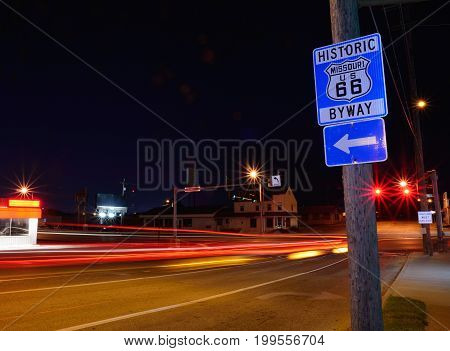 Historic Missouri Route 66 blue Sign at night.