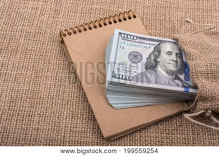 Bundle Of Us Dollar On A Notebook