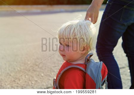 parent walking little daughter to school or daycare