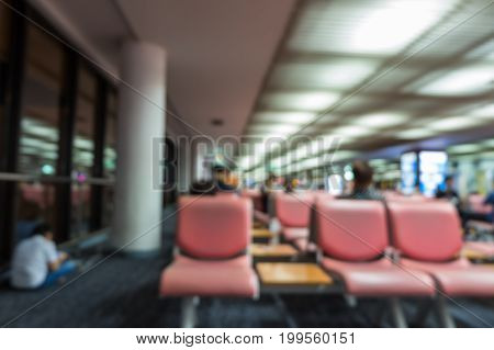 Blurred passenger's seat in the gate during boarding in airport.