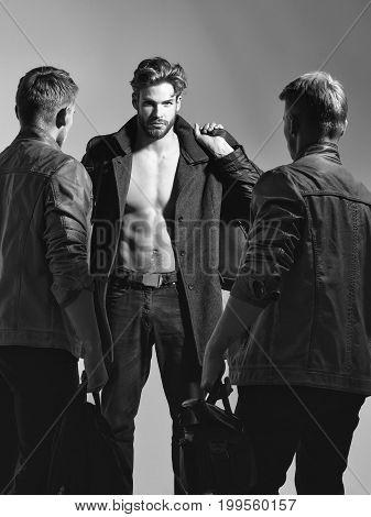guys men or photographer with naked torso and sexy body holds photo camera and bags black and white