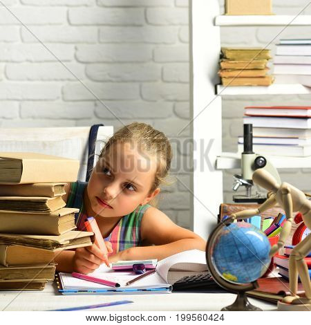 Schoolgirl With Serious Face Draws In Album, Looks At Books