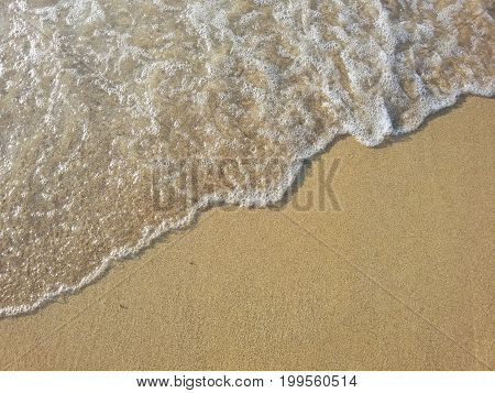 View on a beautiful Beach covered by Crystal clear Water.  Close-up of a Beach in Summer. Natural Background.