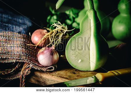 Vintage Image And Soft Light Of Slice Fresh Bottle Gourd Or Calabash With Red Onion For Cooking On W