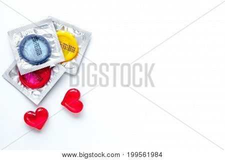 concept male contraception condom on white background top view.
