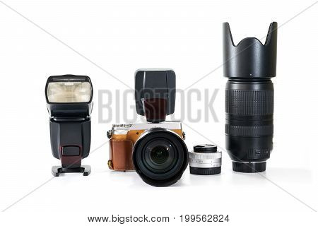 Group of digital camera with lens and flash on white background.
