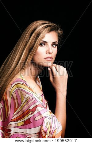 beauty young blonde woman portrait in colorful silky dress studio shot