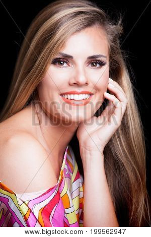 beauty young blonde woman portrait with perfect white smile in colorful silky dress studio shot