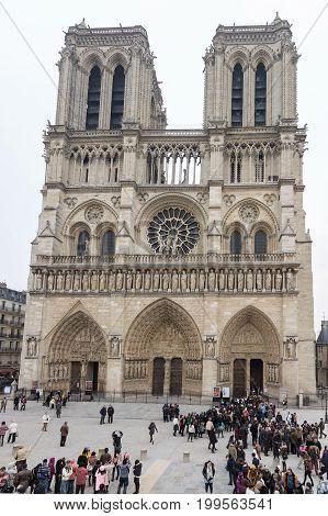 PARIS/FRANCE - MARCH 30, 2013: Cathedral Notre-Dame de Paris with people
