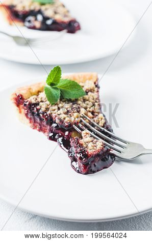Portion Of Pie With Jam On A White Ceramic Plate Over A White Concrete Background