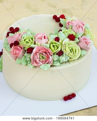 Birthday cake with flowers rose on light background.