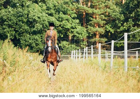 Girl Riding A Horse In Nature