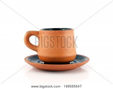 close up brown orange baked clay coffee cup with saucer isolated on white background, simplicity design ceramic cup for hot drink