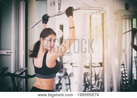 Beautiful Muscular Fit Woman Exercising Building Muscles And Fitness Woman Doing Exercises In The Gy
