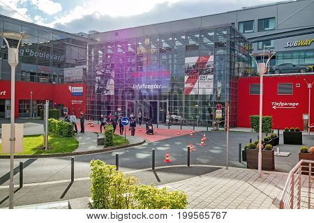 Nurburg Germany - May 20 2017: Race track Nurburgring - info center entrance - modern glass facade building