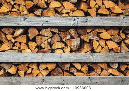 Abstract photo of a pile of natural wooden logs background top view