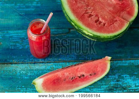 Fresh Watermelon Juice In A Jar With A Straw On A Blue Wooden Table