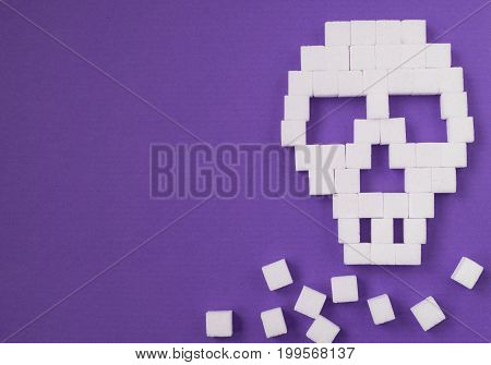 The skull made from sugar cubes. Sugar Kills.  background. diabetes concept. Suggesting dieting concept. Unhealthy white sugar concept. Copy space. Space for text.