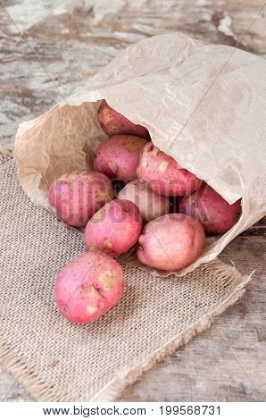 Red Potatoes In A Paper Bag On Table