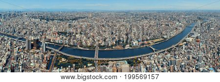 Tokyo urban skyline rooftop view with river, Japan.
