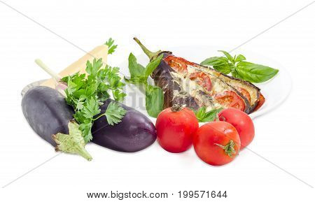 Baked eggplant stuffed with vegetables and cheese decorated with basil leaves on white dish and ingredients for its cooking beside on a white background