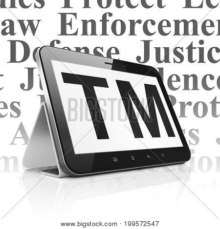 Law concept: Tablet Computer with  black Trademark icon on display,  Tag Cloud background, 3D rendering