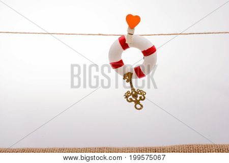 Life preserver attached to a string with heart icon