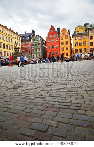 Angle shot of famous Stortorget square in Stockholm , Sweden. Copyspace composition. All people are in motion blur!