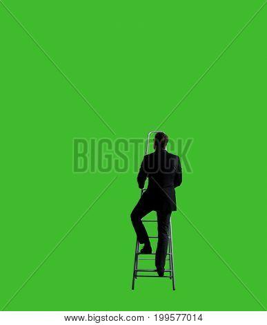 Businessman standing on ladder over chroma key background. Business, career job concept.