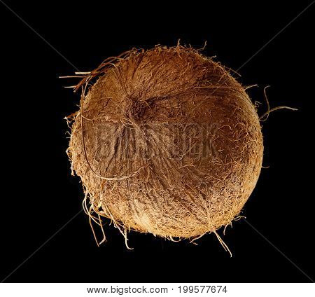 Fragrant tasty coarse coconut on a black background